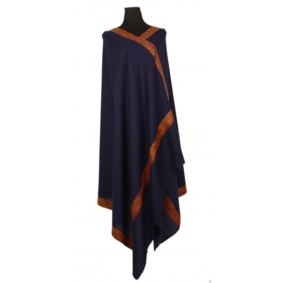 A rich navy blue shawl with intricately embroidered borders